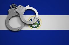 El Salvador flag and police handcuffs. The concept of crime and offenses in the country.  stock image