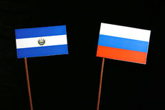 El Salvador flag with Russian flag isolated on black. Background royalty free stock photo