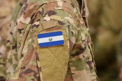 El Salvador flag on soldiers arm. Republic of El Salvador troops collage.  stock image