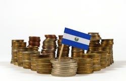 El Salvador flag with stack of money coins. El Salvador flag waving with stack of money coins royalty free stock photography