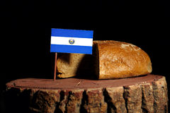 El Salvador flag on a stump with bread. Isolated stock photography