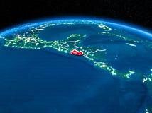 El Salvador från utrymme på natten Arkivfoto