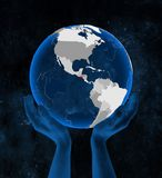 El Salvador on globe in hands. El Salvador on translucent blue globe held in hands in space. 3D illustration royalty free illustration