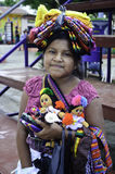 El Salvador native girl. A portrate of a poor young native El Salvadorian girl selling her goods in the market square for the families income Stock Image
