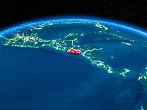 El Salvador from space at night. Orbit view of El Salvador highlighted in red with visible borderlines and city lights on planet Earth at night. 3D illustration Stock Photo
