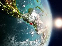 El Salvador during sunrise. Highlighted in red on planet Earth with visible country borders. 3D illustration. Elements of this image furnished by NASA Stock Image