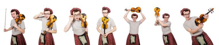 El scotsman divertido con el violín en blanco Fotos de archivo