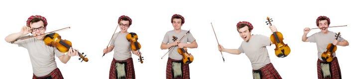 El scotsman divertido con el violín en blanco Imágenes de archivo libres de regalías