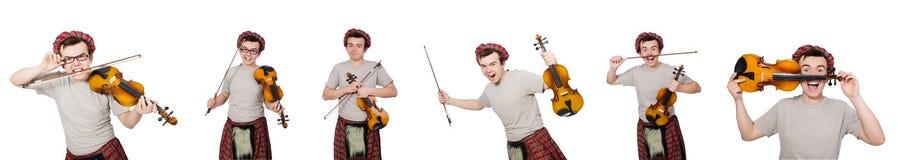 El scotsman divertido con el violín en blanco Foto de archivo libre de regalías