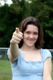 El señalar adolescente de la muchacha Foto de archivo libre de regalías