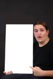 El señalar adolescente en la muestra en blanco Fotos de archivo