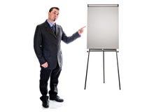 El señalar al caballete de la presentación Hombre en traje imagen de archivo
