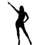 El señalar con estilo de la postura del baile de la mujer de la silueta Imagen de archivo