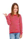 El señalar de la muchacha aislado en el fondo blanco Fotos de archivo libres de regalías