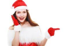 El señalar de la muchacha de la Navidad Imagenes de archivo