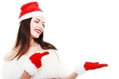 El señalar de la muchacha de la Navidad Fotografía de archivo