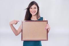 El señalar de la muchacha del negocio Imagen de archivo