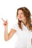 El señalar de la mujer aislado en el fondo blanco Imagen de archivo libre de regalías