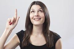 El señalar de la mujer joven Imágenes de archivo libres de regalías