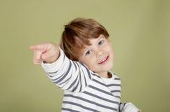 El señalar de risa feliz del niño Fotografía de archivo