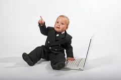 El señalar del ejecutivo de ventas del bebé imagen de archivo libre de regalías