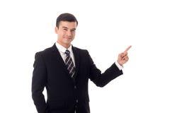 El señalar del hombre de negocios aislado foto de archivo