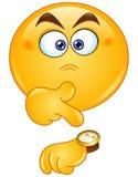 El señalar en el emoticon del reloj Imagen de archivo libre de regalías