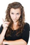 El señalar femenino joven con el índice Foto de archivo libre de regalías