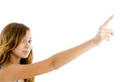 El señalar hermoso de la muchacha Foto de archivo libre de regalías