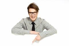 El señalar joven del hombre de negocios Foto de archivo