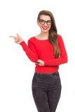 El señalar sonriente de la muchacha del empollón Imagen de archivo libre de regalías