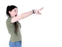 El señalar sorprendido de la muchacha Imagen de archivo libre de regalías