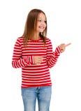 El señalar de la muchacha aislado en el fondo blanco Imagen de archivo libre de regalías