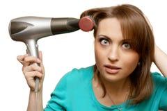 El secador de la muchacha y de pelo Fotografía de archivo libre de regalías