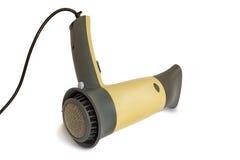 El secador de pelo para secarse del pelo en un fondo blanco Imagen de archivo libre de regalías
