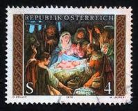 El sello de la Navidad impreso en la Austria muestra la guardería de la Navidad Fotos de archivo