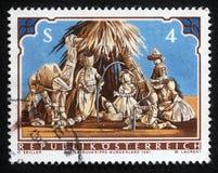 El sello de la Navidad impreso en la Austria muestra la guardería de la Navidad Foto de archivo libre de regalías