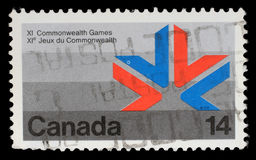 El sello impreso en Canadá muestra un símbolo XI de los juegos de la Commonwealth Foto de archivo