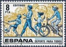El sello impreso en España muestra el deporte para todos Foto de archivo