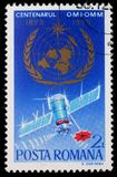 El sello impreso en Rumania muestra el 100o aniversario de la organización meteorológica de mundo Foto de archivo