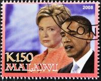 El sello muestra Barack Obama con Hillary Clinton Foto de archivo