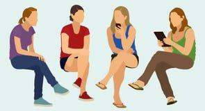 El sentarse adolescente de las muchachas Imagen de archivo