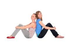 El sentarse de las muchachas Fotografía de archivo libre de regalías