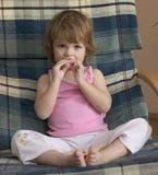 El sentarse en la butaca Fotografía de archivo