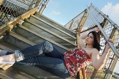 El sentarse en las escaleras Foto de archivo libre de regalías