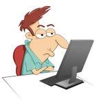 El sentarse en su ordenador Fotografía de archivo libre de regalías