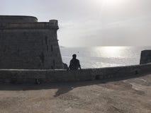 El sentarse en un castillo foto de archivo libre de regalías