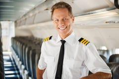 El sentirse confiado en su avión Foto de archivo libre de regalías