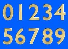 El sistema de 3D rindió los números, 0-9 Color brillante de oro en el fondo azul para el uso fácil Imagen de archivo