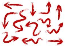 El sistema de flechas pintó el cepillo áspero a mano Movimientos rojos duros 12 Imagen de archivo